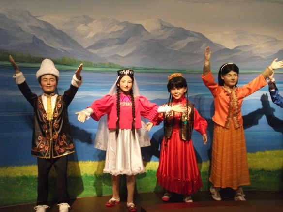 "A portrayal of ""ethnic diversity and integration"" in a museum in Urumqi."
