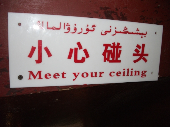 Not just Chinglish, this 3-way sign draws in the Uyghur language as well. Lol.