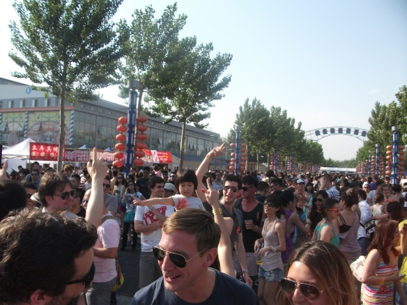 Intro - Beijing's biggest electronic music festival. Notice the little girl on the woman's shoulders.